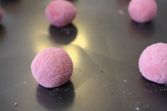 Roll your dough into one inch balls, then roll in remaining ground cinnamon candy powder that you set aside.